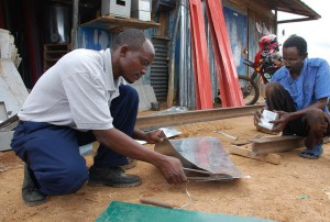 Workshop on making metal silos for grain storage, Kenya