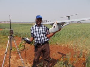 Charles Mutimaamba, Chief Research Officer and Maize Breeder at the CBI, pauses for a photo with the Skywalker in a field.